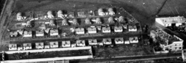 1954 aerial view of Queens Road and its temporary housing - this clip is from Merton Memories photo 49269 and is copyright London Borough of Merton.