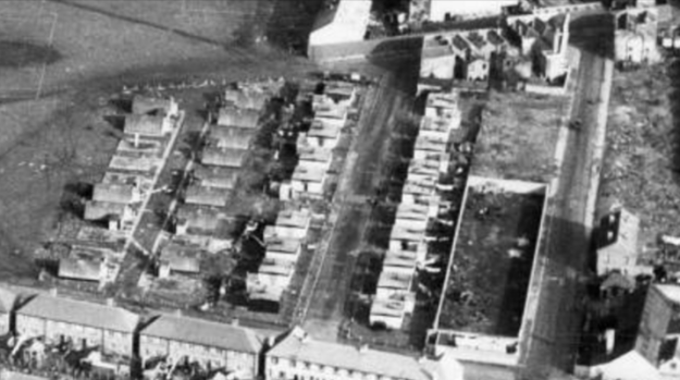 1954 aerial view of Queens Road and its temporary housing, looking east. This is a clip from Merton Memories photo 49278, and is copyright London Borough of Merton.