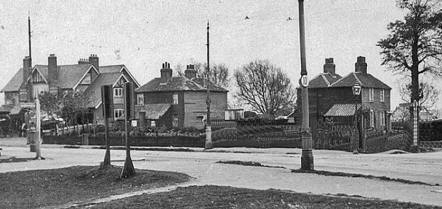 From a Percy Mayhew postcard. The Ravensbury Arms is on the left.