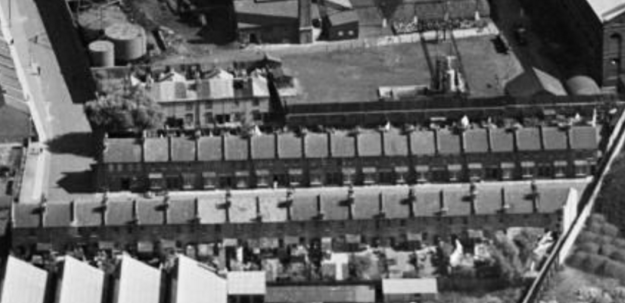 1937 aerial view looking to east. At top of photo is the Mitcham Gas Works. On the right, the footpath is Field Gate Lane. On the bottom of the photo can be seen part of the factory roof of Standard Upholstery.