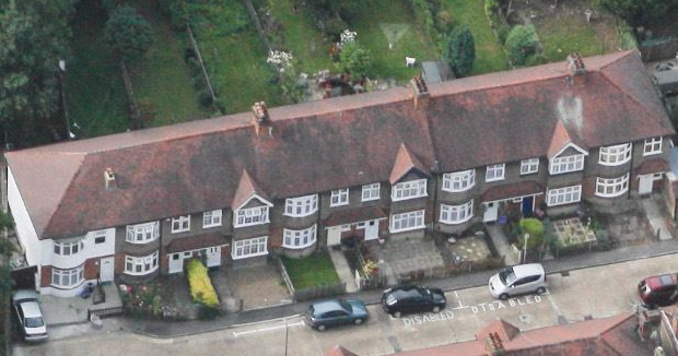 Aerial view, looking northwards, of Queen Annes Gardens, numbers 2 to 16 (south side).