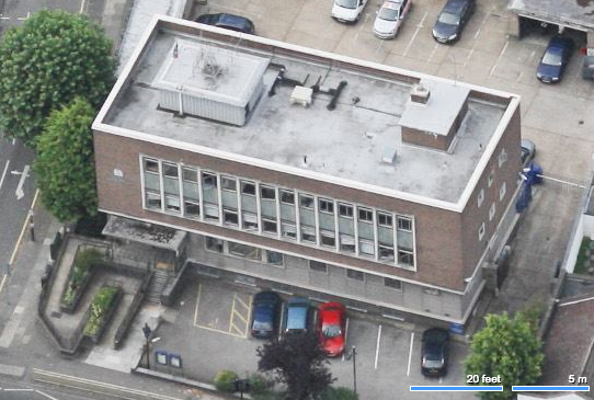 Aerial view showing front of building.